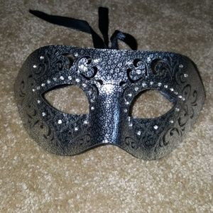 Never used silver and black unisex mask